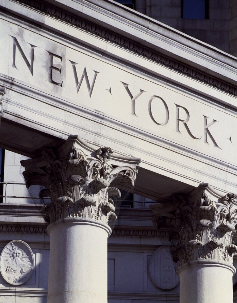 Architectural detail of a New York building illustrating a web page about New York Law services in New York State.